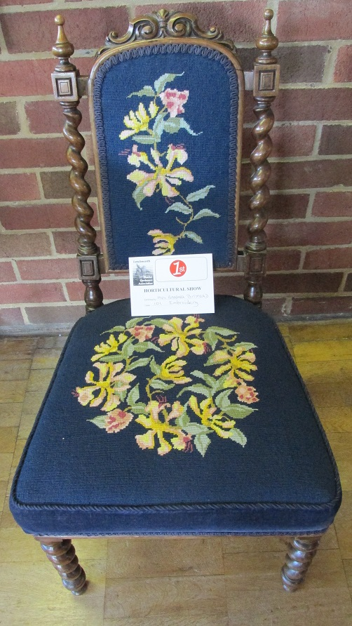 A chair with embroidered upholstery