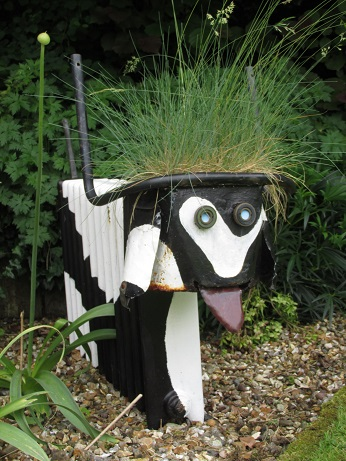 A sculpture of cow made from an old radiator
