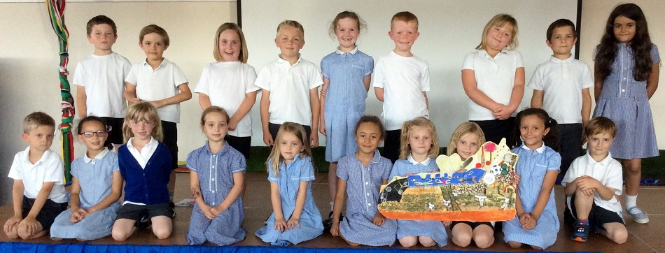 Children form the Gardening Club present their collage at school assembly
