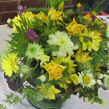 A floral arrangement in yellow