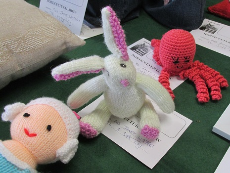 Knitted octopus, rabbit and doll soft toys