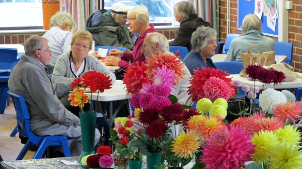Visitors enjoying refreshments with dahlias in the foreground