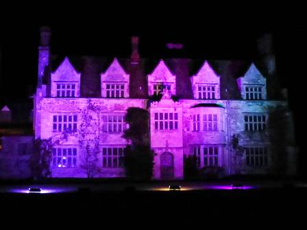 Winter lights at Anglesey Abbey - the abbey itself lit in magenta light