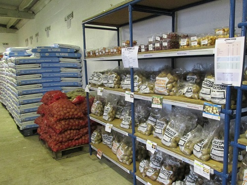 Bags of seed potatoes on the shelf