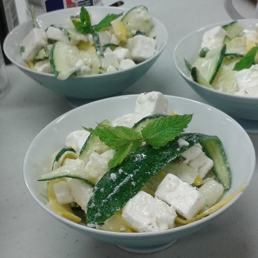 A bowl of minted courgette and feta salad