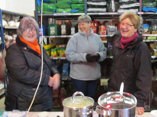 Ladies serving soup at Potato Day