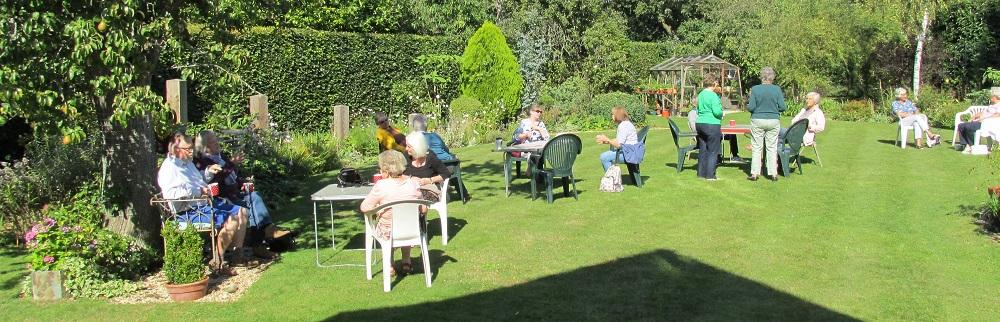 Members enjoying Val Aitken's garden